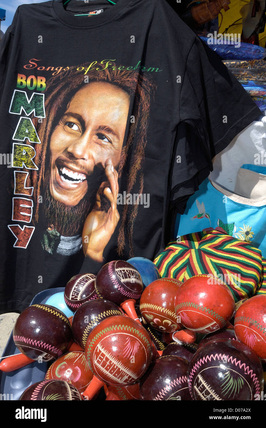 Reggae music legend Bob Marley tee shirt and cricket balls on a Market  Stall , Marigot ,Sint Maarten - Stock Image