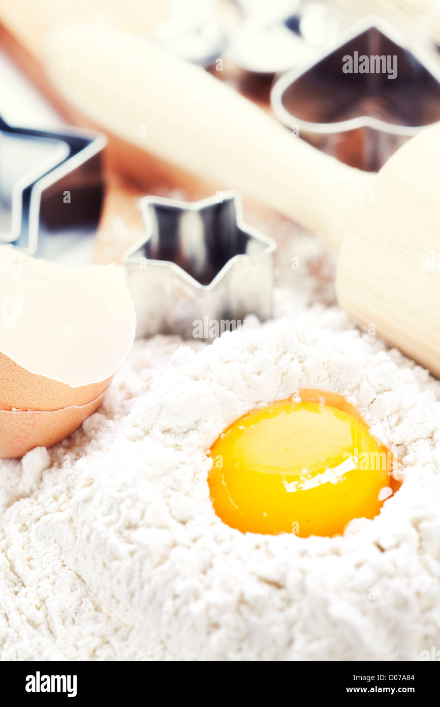 Baking cookies: eggs, flour and baking forms - Stock Image