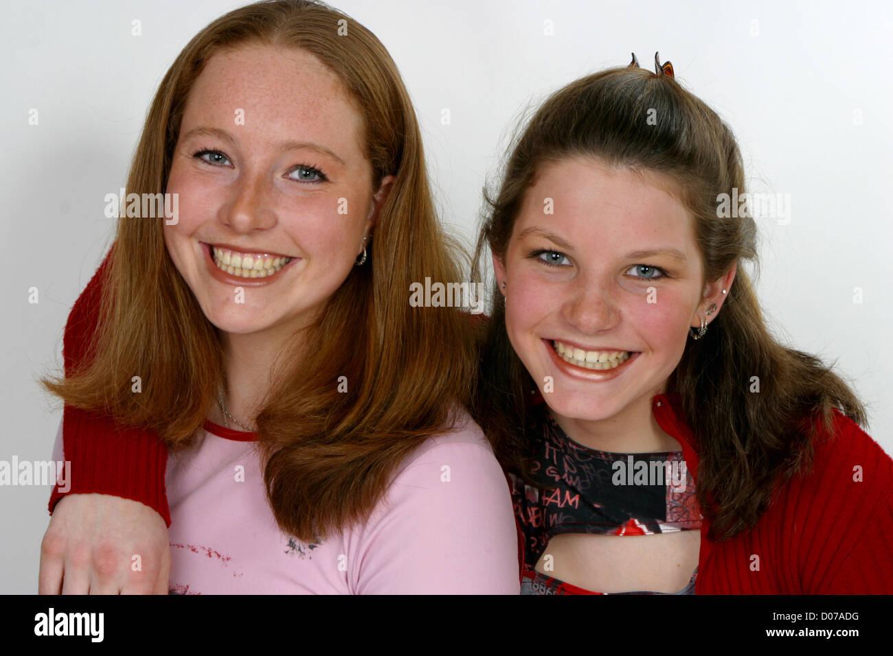 Happy portrait teenage siblings - Stock Image