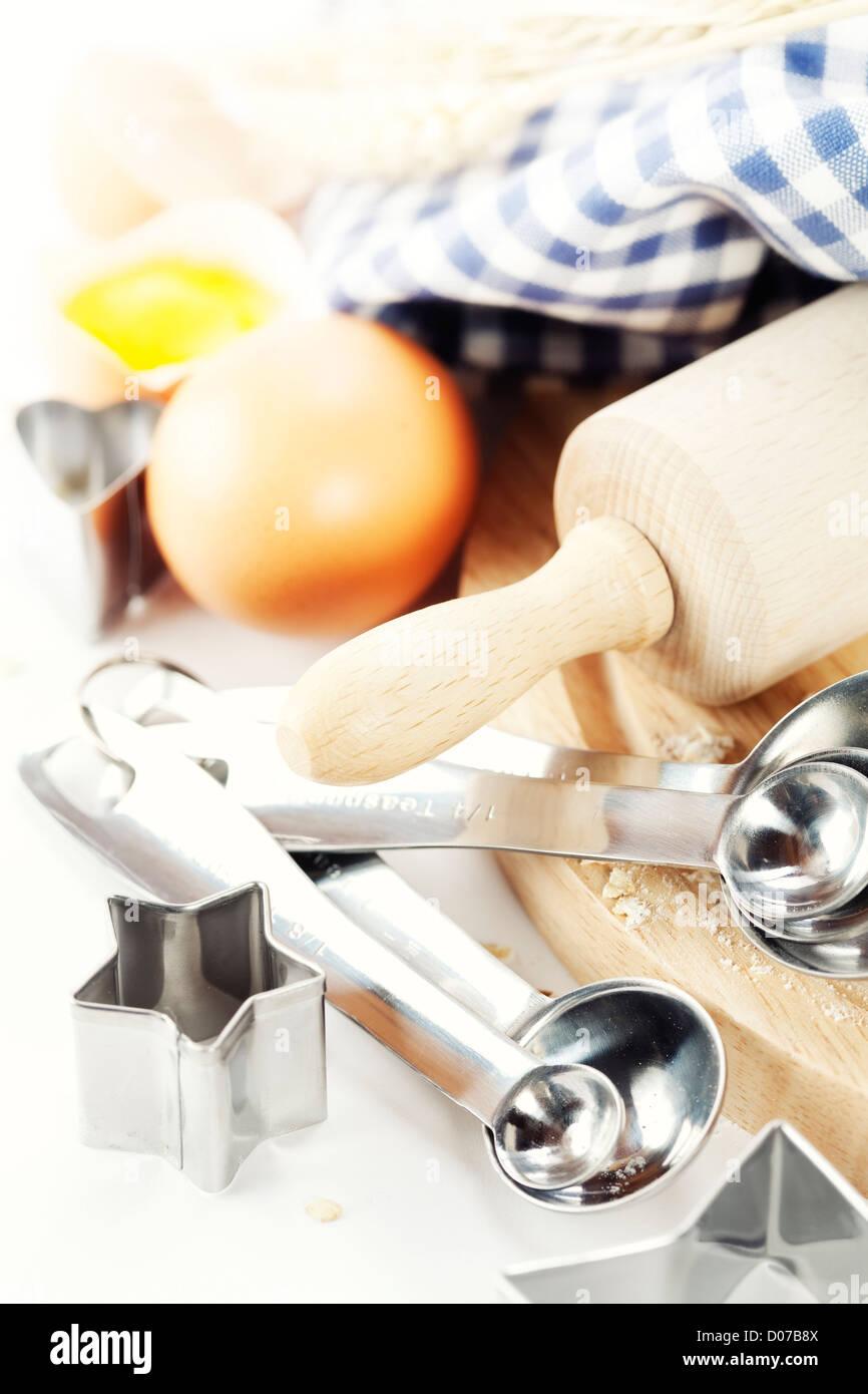 Basic baking ingredients over white - Stock Image