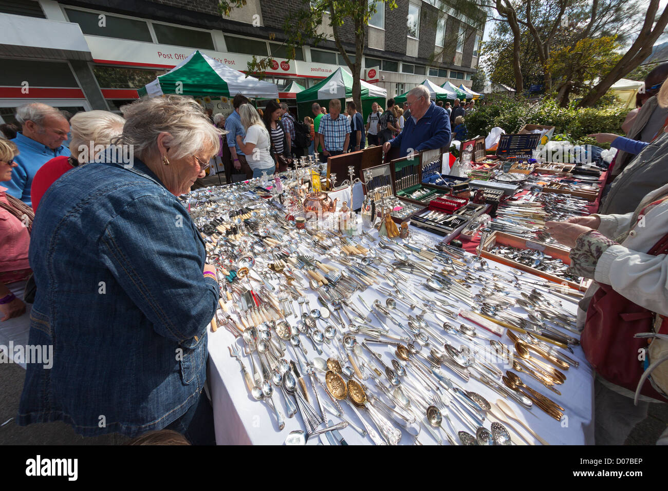 Used silverware and cutlery on sale at market stand, Abergavenny Food Festical, Wales, UK - Stock Image