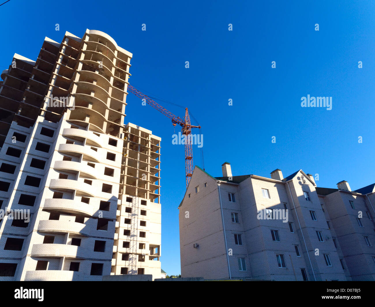 Construction of new residential buildings by pouring concrete Stock Photo