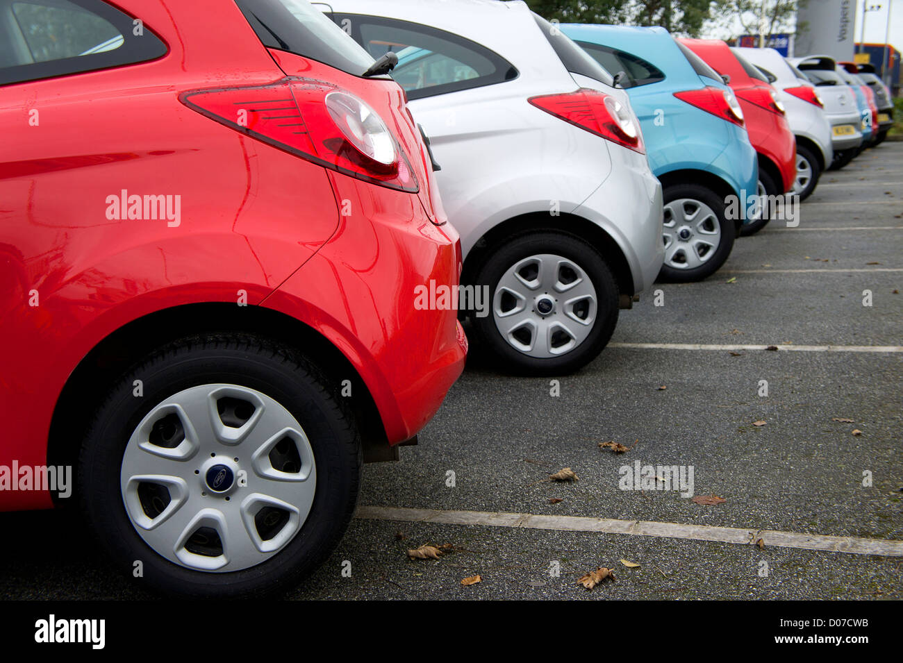 Ford KAs on a garage forecourt - Stock Image