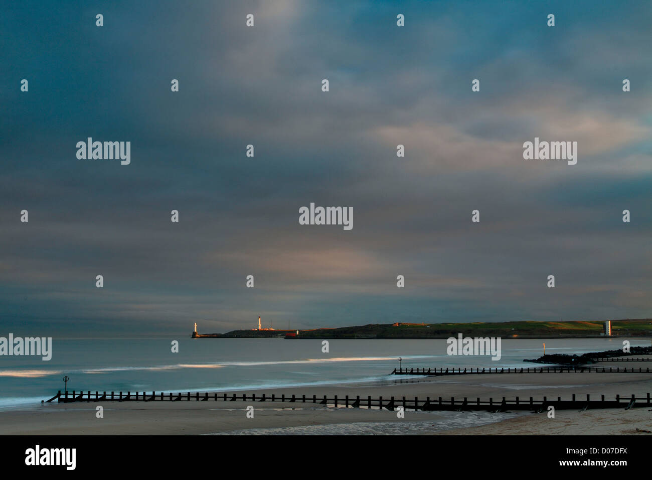 Girdle Ness and the North Sea from Aberdeen Beach at dusk, Aberdeenshire - Stock Image