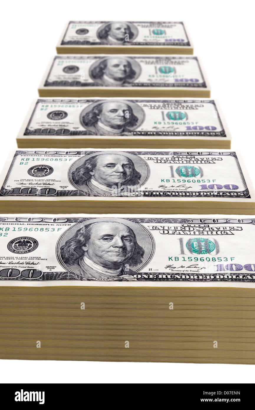 stacks of one hundred dollar bills in a line on white - Stock Image