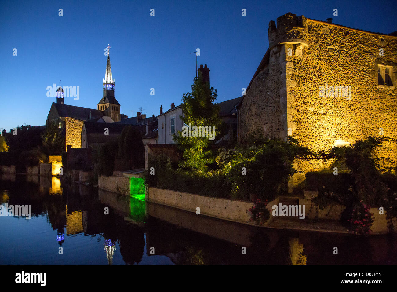 NIGHTTIME LIGHTING FORTIFICATIONS MOATS MEDIEVAL CITY MEDIEVAL CITY BONNEVAL NICKNAMED LITTLE VENICE BEAUCE EURE - Stock Image