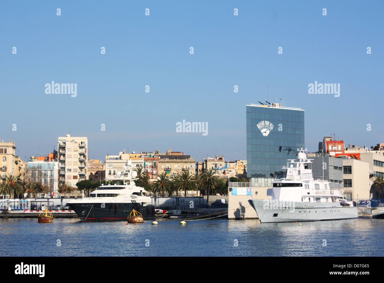 Boats and buildings in Barcelona city, Spain Stock Photo