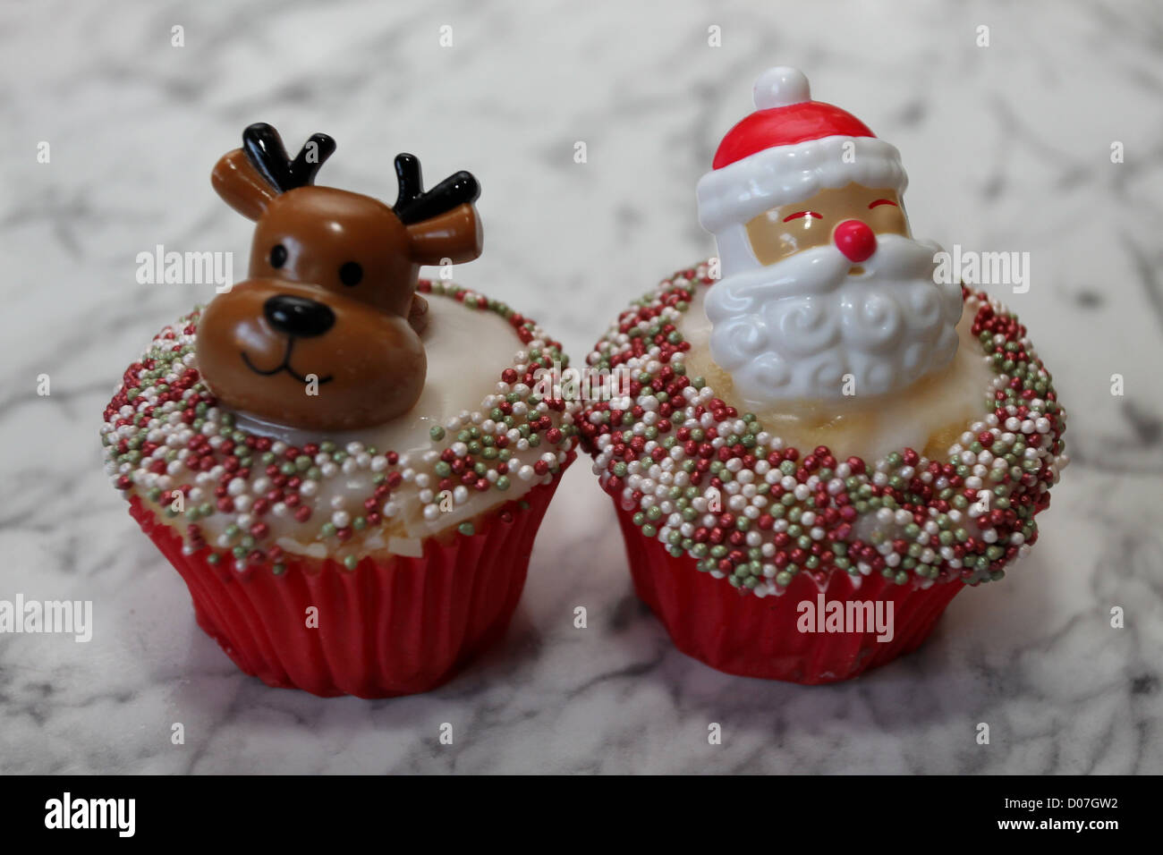 Christmas Cupcakes On A Kitchen Table In Hove East Sussex Uk Stock