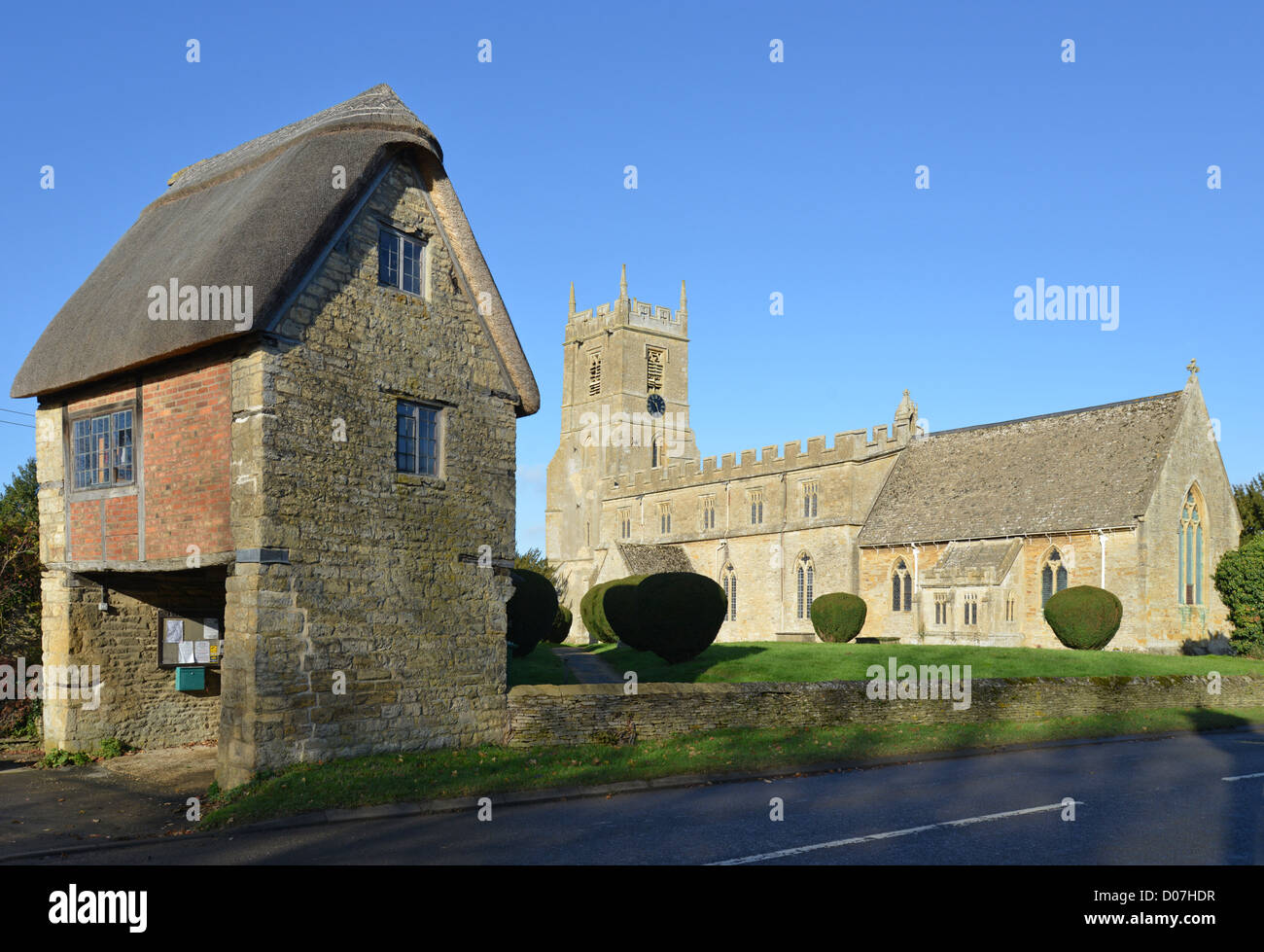 The Lych gate and 13th century Church of St Peter and St Paul, Long Compton, Warwickshire, England, United Kingdom - Stock Image