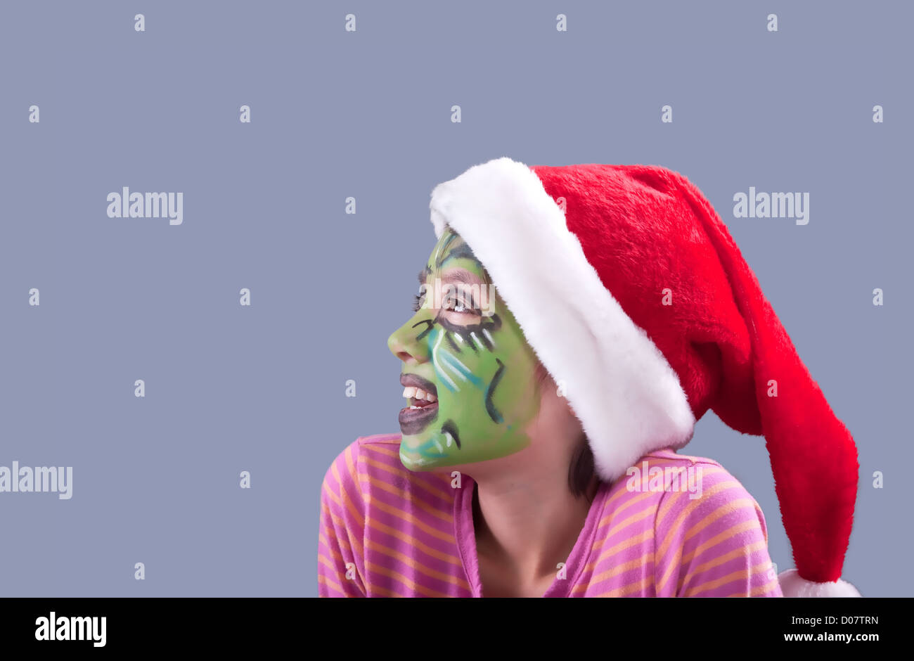 A Young Girl Wears A Santa Hat And Has Face Paint Similar To The Stock Photo Alamy
