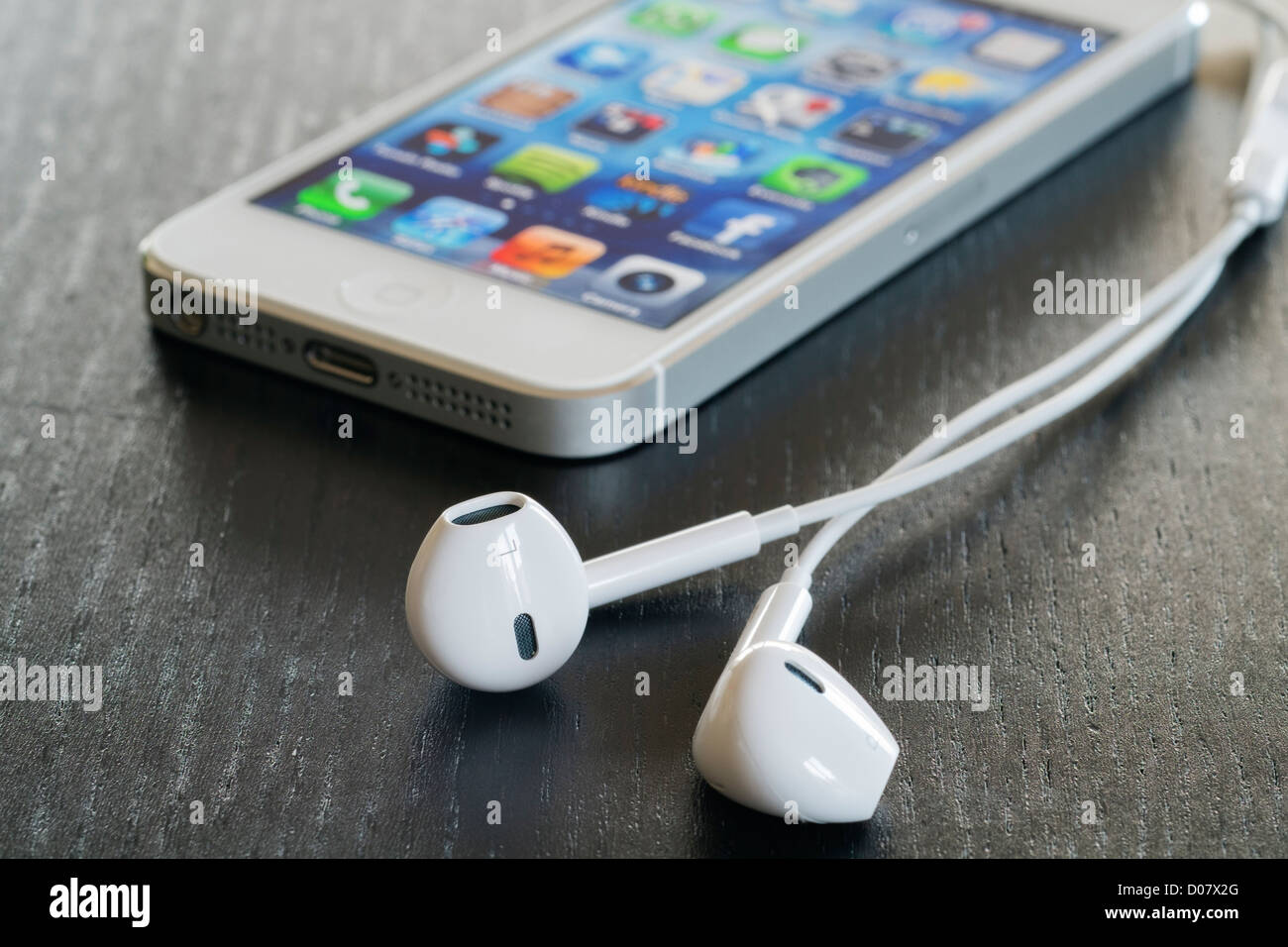 Detail of iPhone 5 and earphones - Stock Image