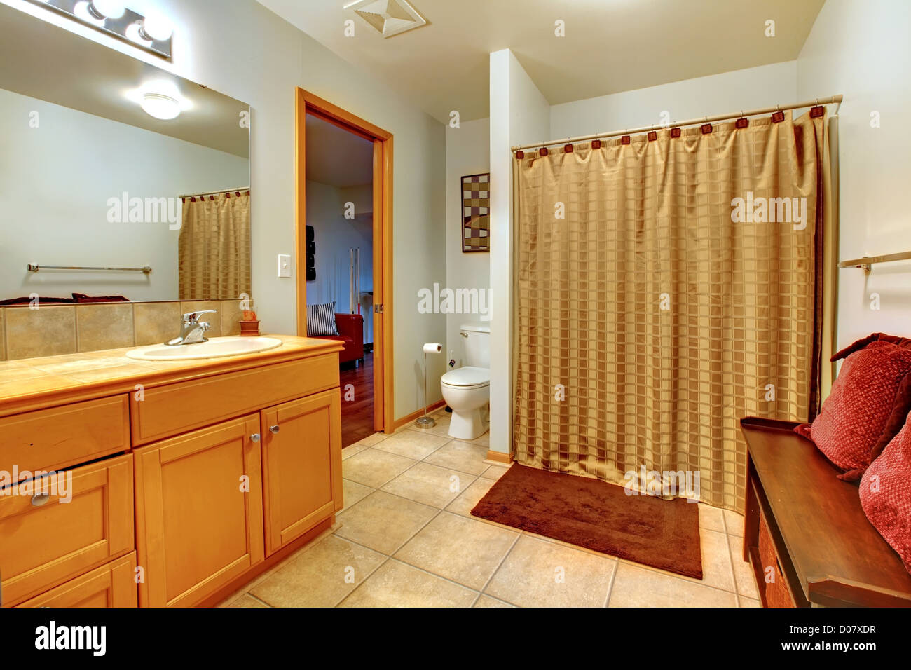 Large bathroom interior with bench with red pillows and shower Stock ...