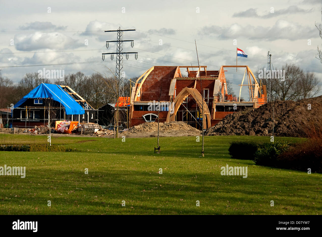 Building house and reached the top, put a flag on it, Dutch habit. - Stock Image