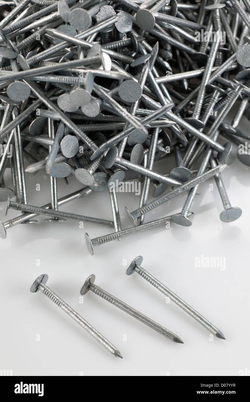 Pile of 50mm galvanised felt nails - Stock Image