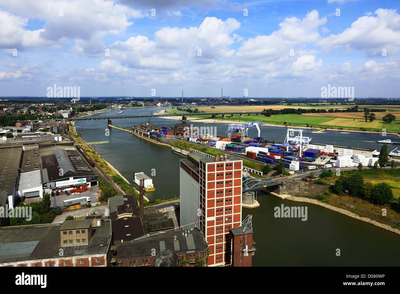 Panoramablick ueber den Rheinhafen Krefeld und die Rheinbruecke zwischen Krefeld-Uerdingen und Duisburg-Muendelheim, - Stock Image