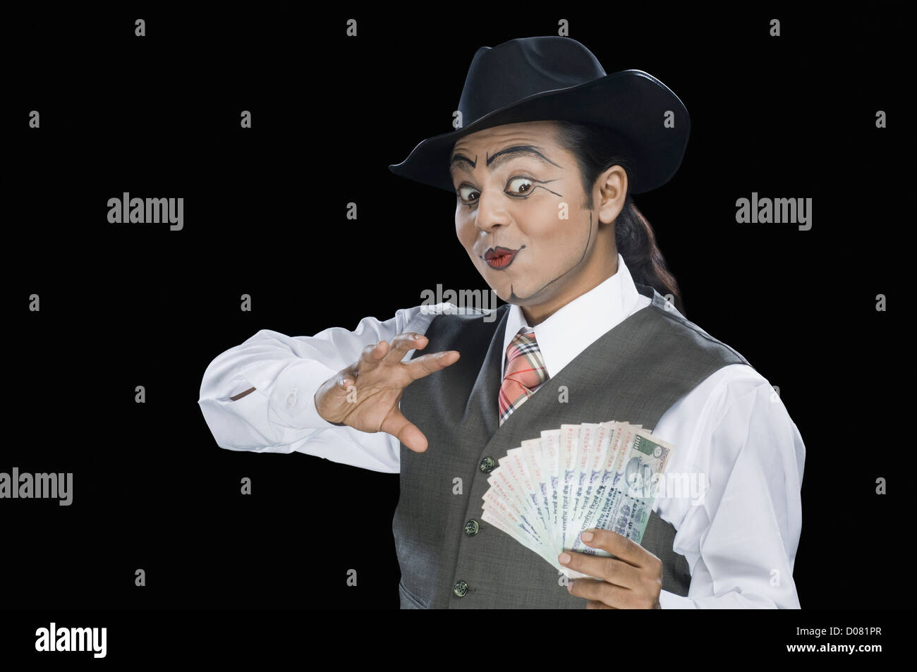 Close-up of a mime performing magic trick - Stock Image