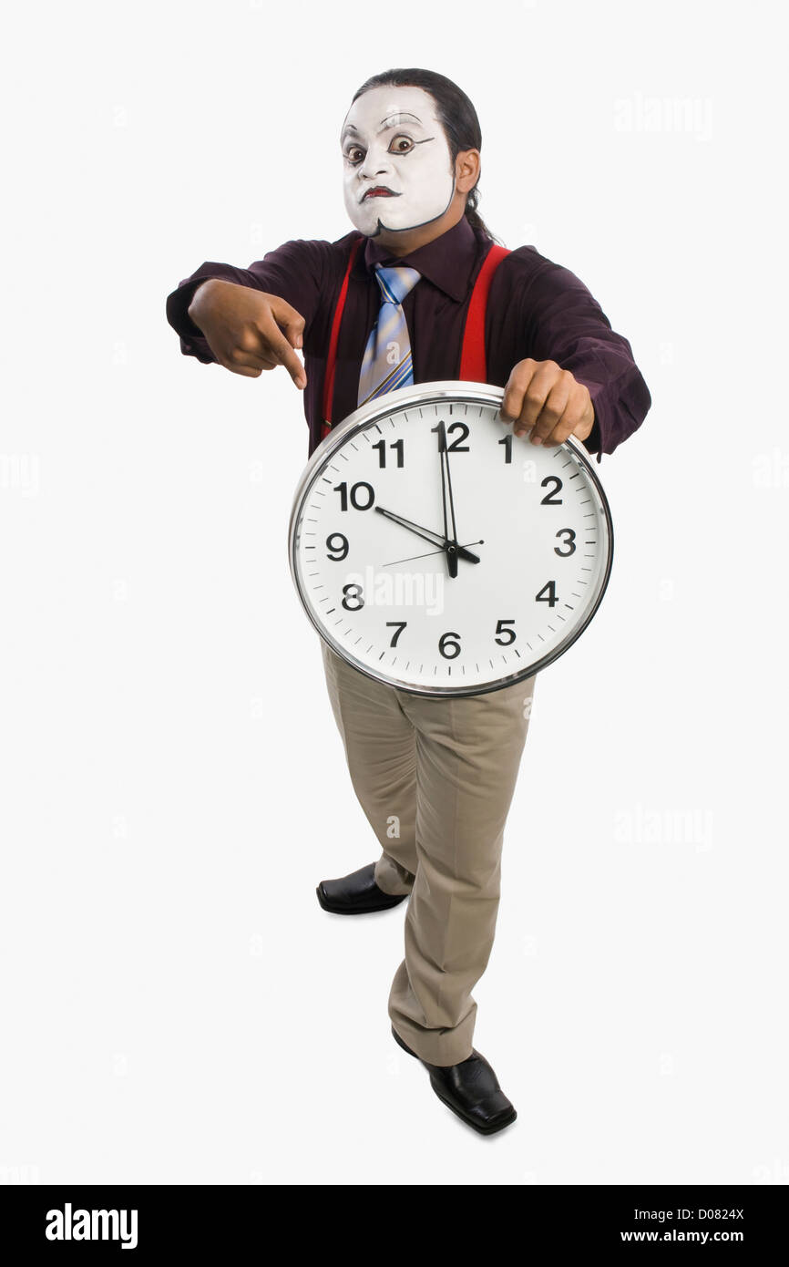 Mime showing a clock - Stock Image
