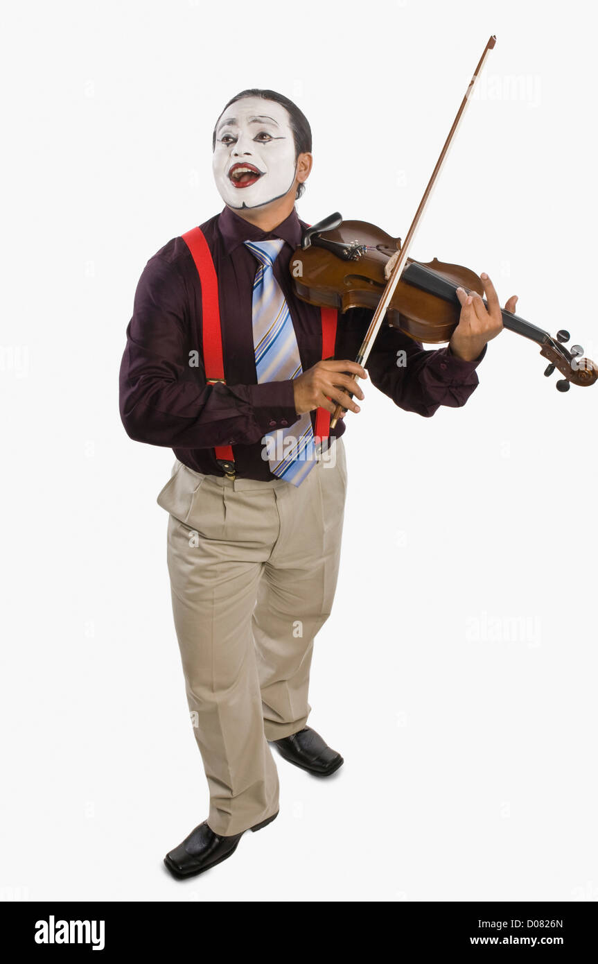 Mime playing a violin - Stock Image