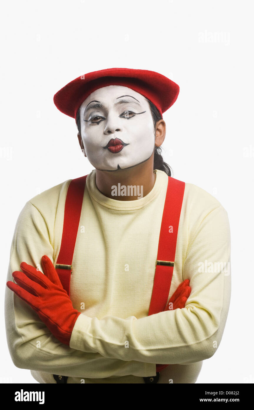 Portrait of a mime puckering - Stock Image