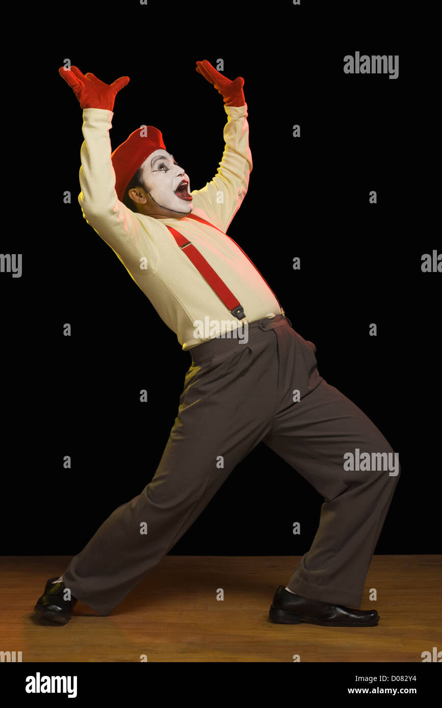 Mime performing on a stage - Stock Image