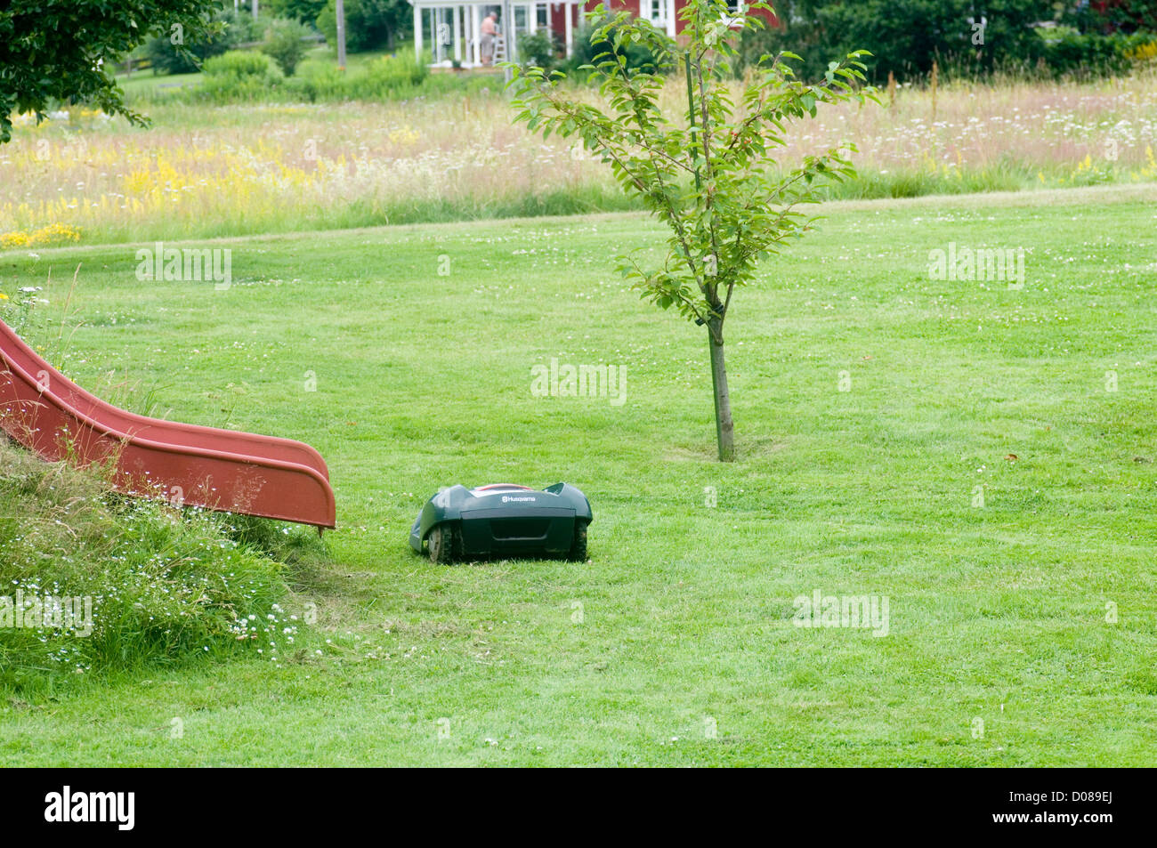 husqvarna robotic robot mower mowers grass cutter cutting the garden hi tech Stock Photo