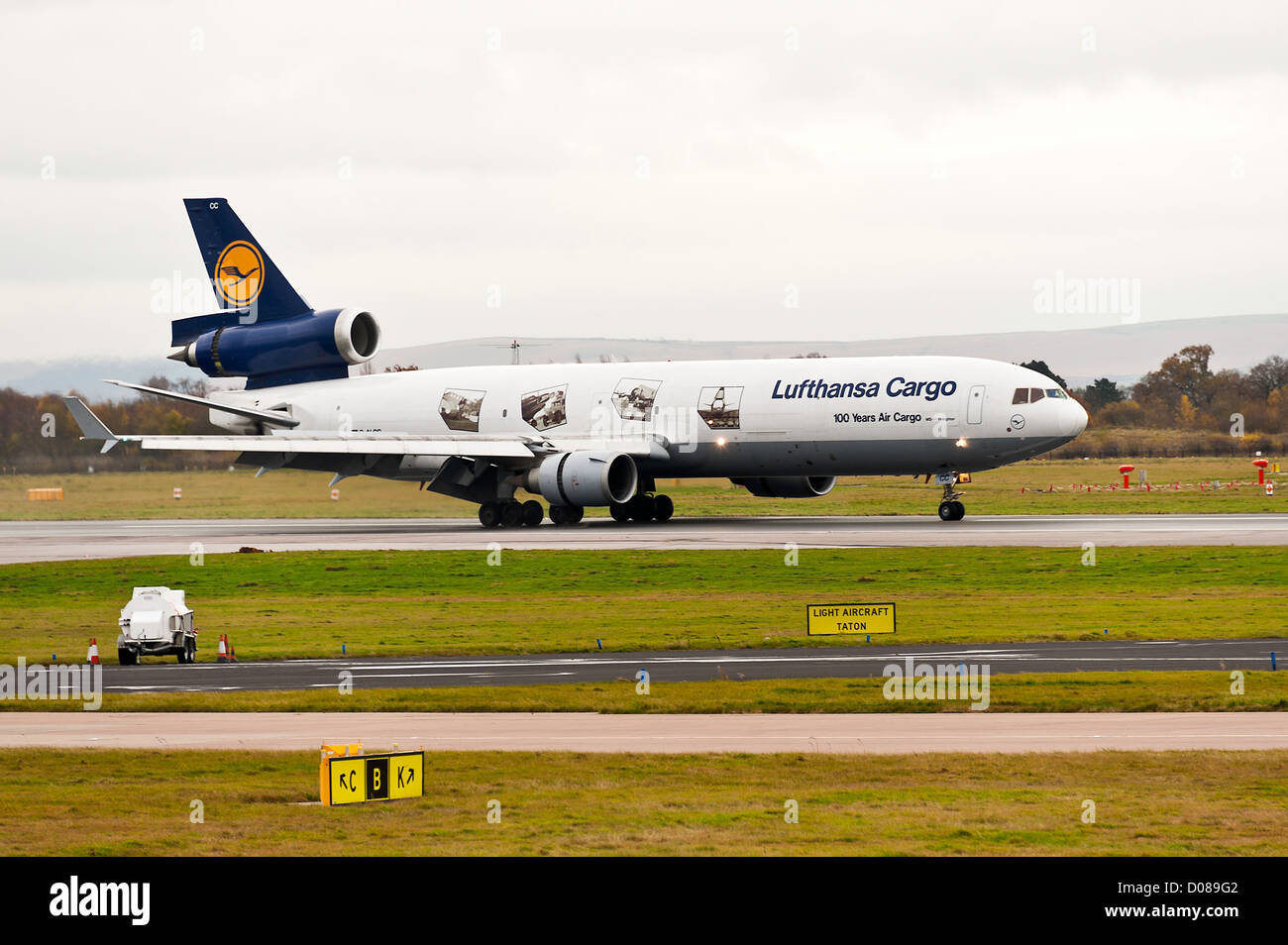 Lufthansa Cargo Airlines Mc Donnell Douglas MD-11F Freighter Airliner D-ALCC Landing at Manchester Airport England Stock Photo