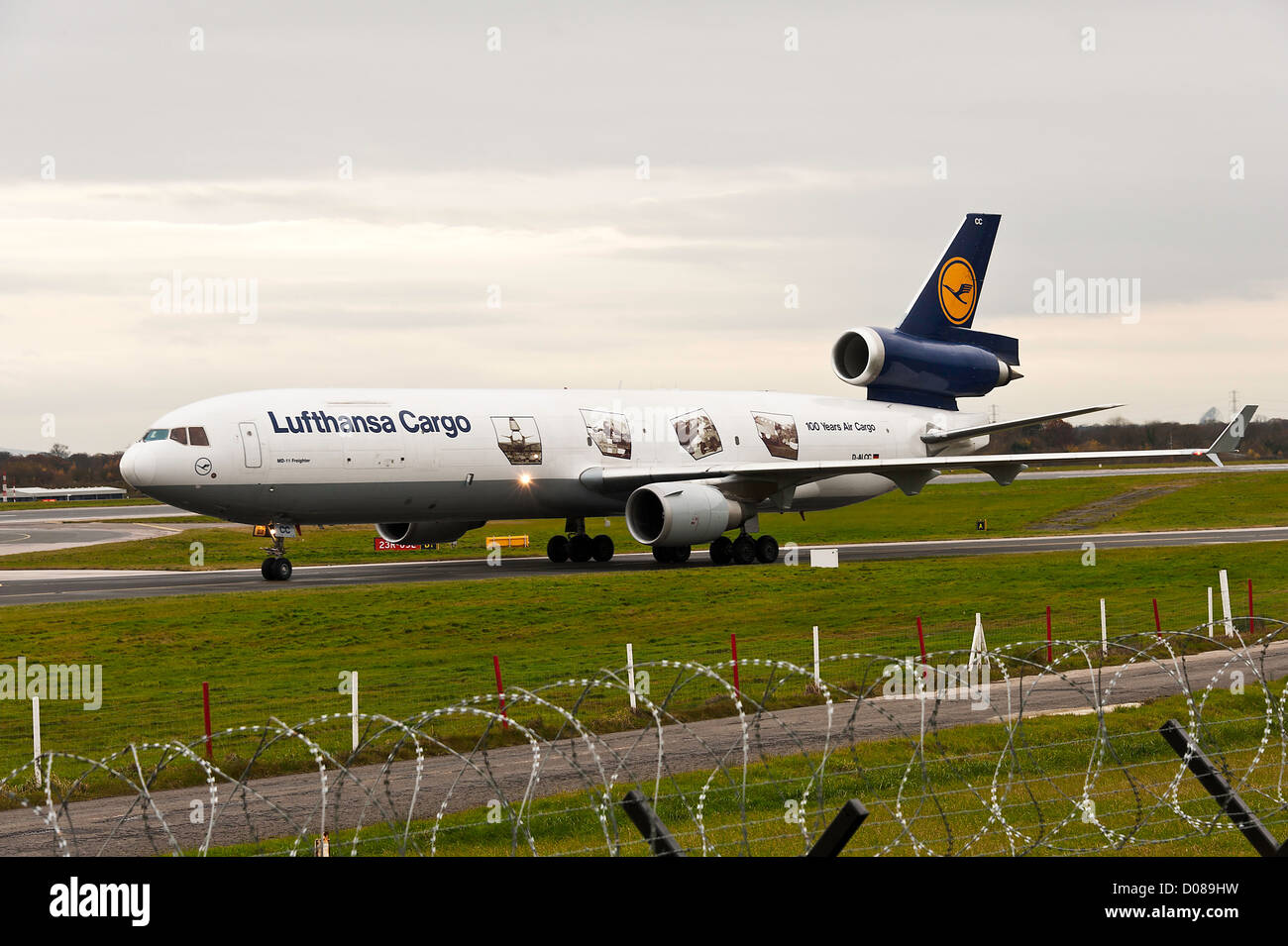 Lufthansa Cargo Airlines Mc Donnell Douglas MD-11F Freighter Airliner D-ALCC Taxiing at Manchester Airport England Stock Photo