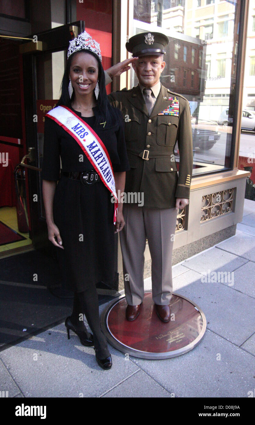 Mrs. Maryland America  Raquel Riley Thomas poses with General Dwight Eisenhower's wax work at Madame Tussauds WashingtonStock Photo