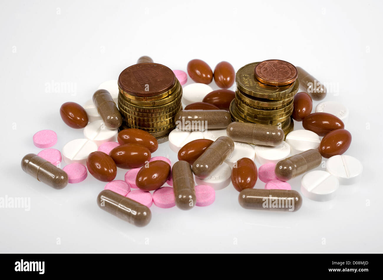 Euro coins between pills and medicines - Stock Image