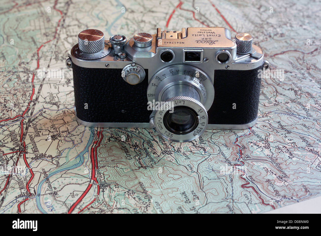 Leica IIIc rangefinder camera from 1930s on travel map - Stock Image