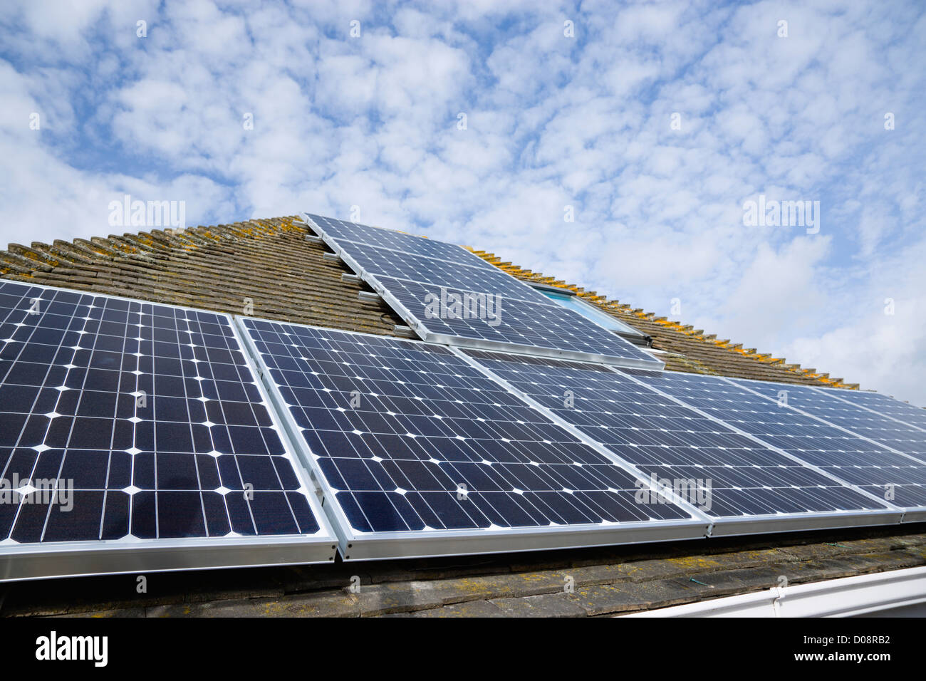 Architecture, Alternative Energy, Electricity, Solar photovoltaic roof panel on detached house for electricity conversion. - Stock Image