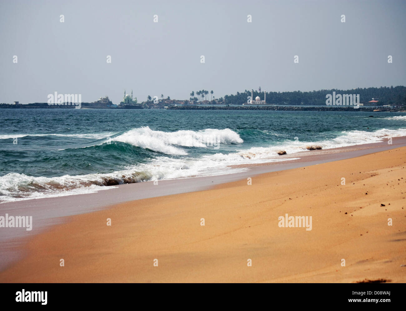 Beach view - tides rising onto the shore - Stock Image