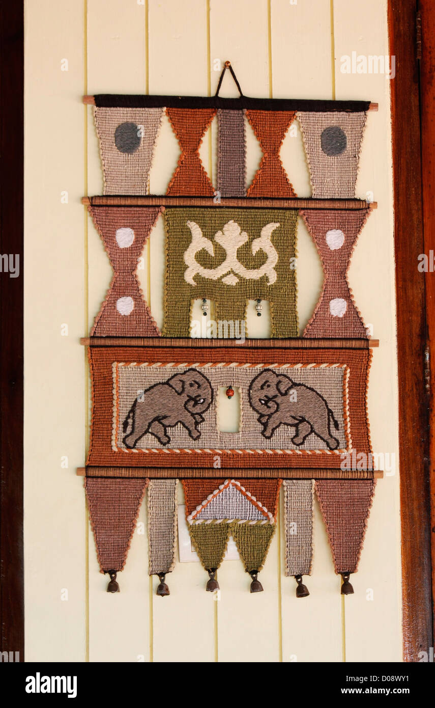 A handicraft design pattern hanging on the wall - Stock Image