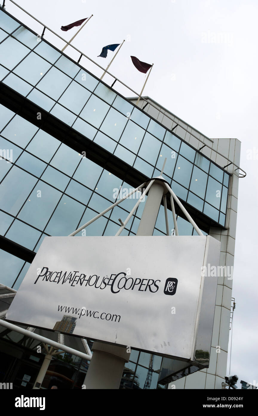 Price waterhouse cooper PwC sign outside building on canary wharf - Stock Image