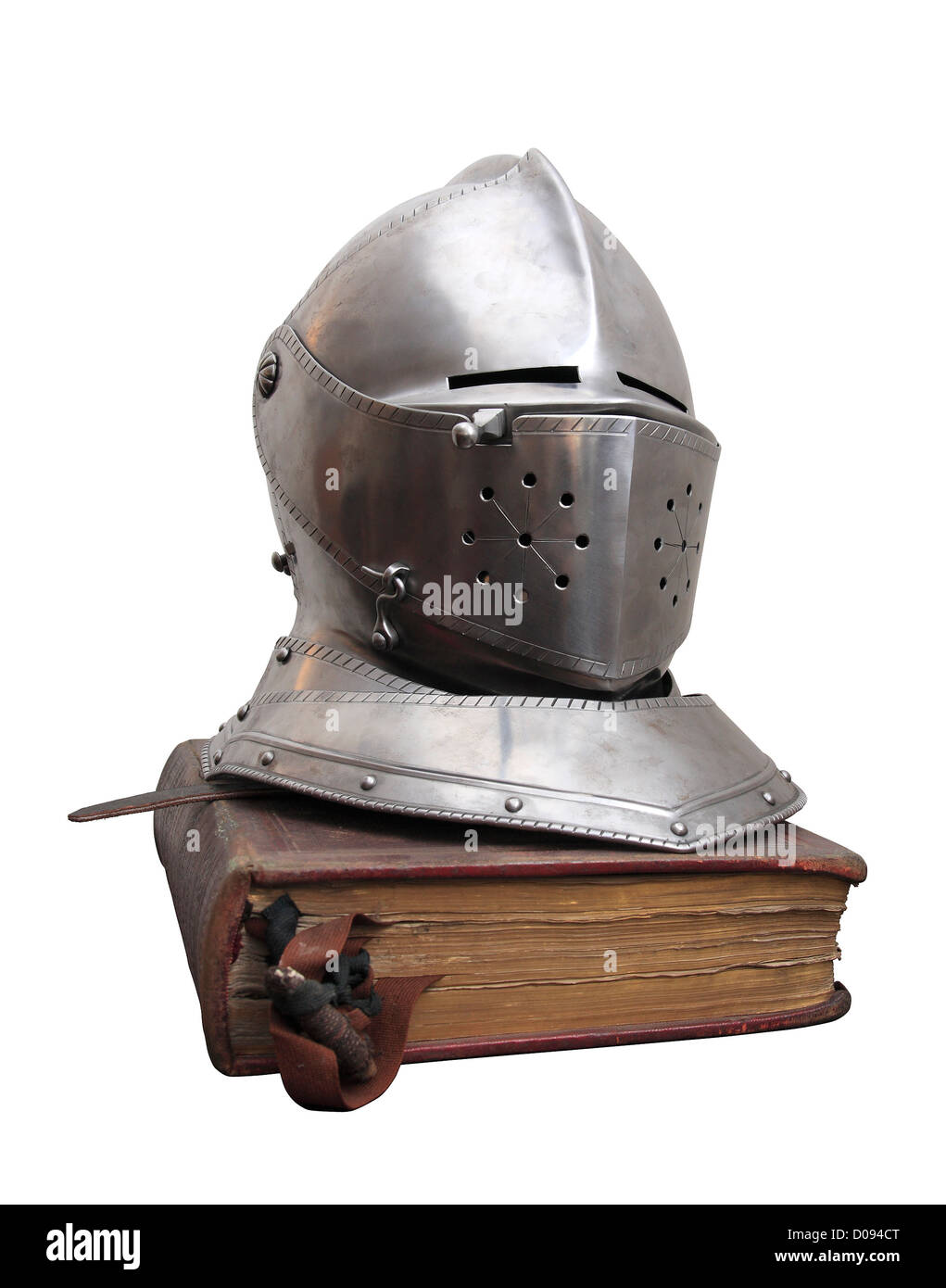 A knight's helmet on an old book. - Stock Image