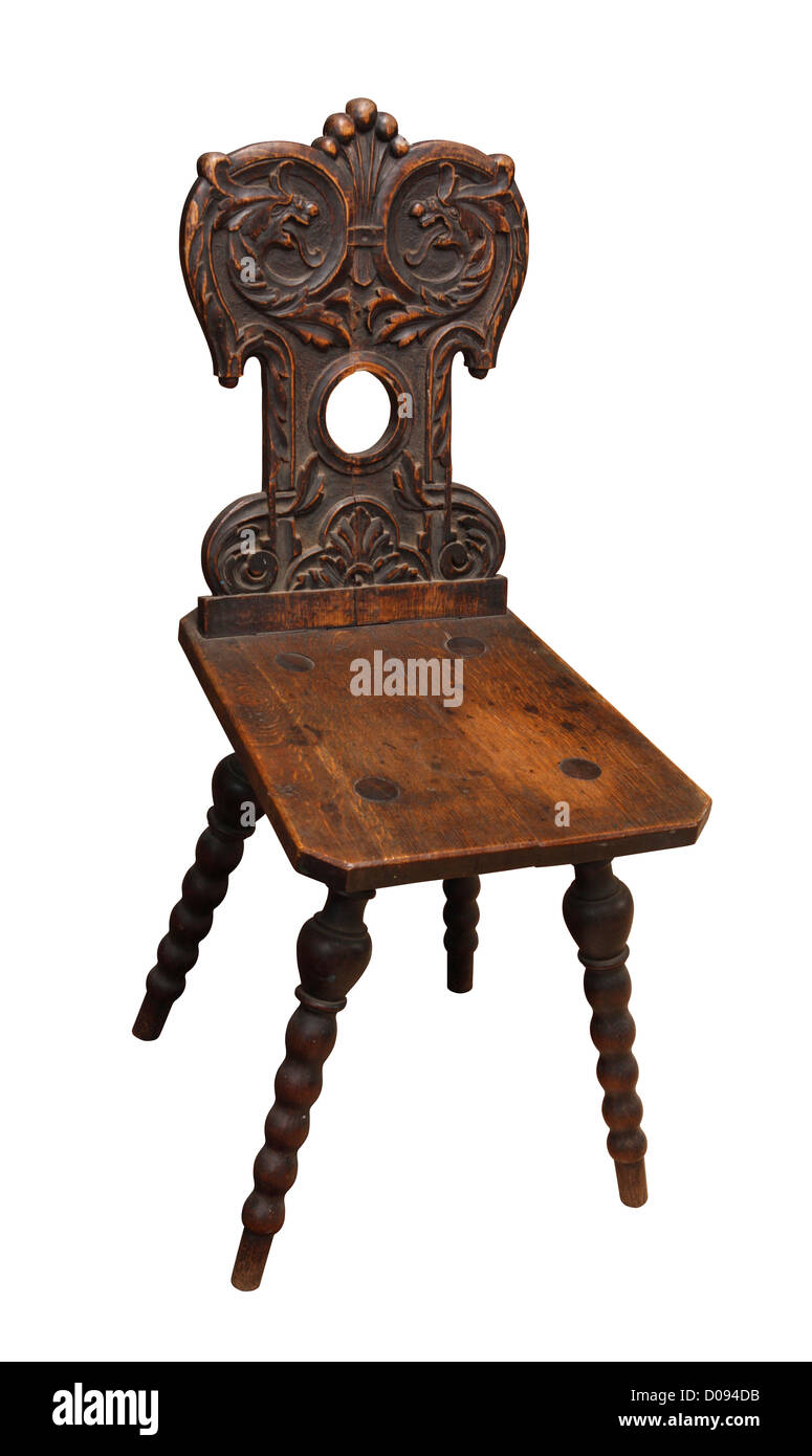 Old wooden chair decorated with floral pattern. - Stock Image