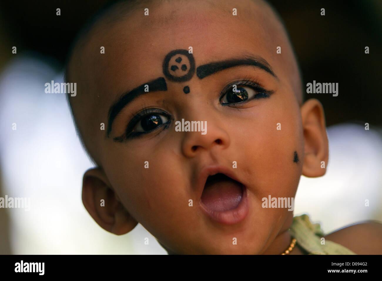 A child wearing kajal make up a natural black coloured balm both make