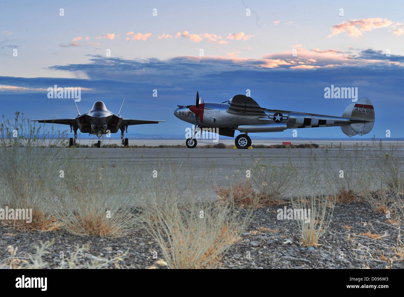 The Lockheed Martin F-35 Lightning II meets its namesake, the P-38 Lockheed Lightning - Stock Image