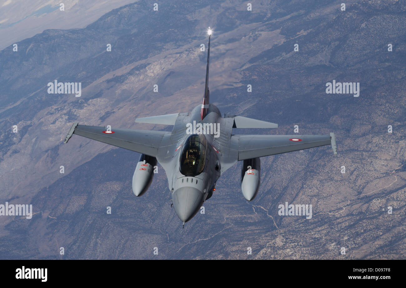 An F-16 aircraft chases an F-35 test flight at Edwards AFB, Calif., in May 2012. - Stock Image