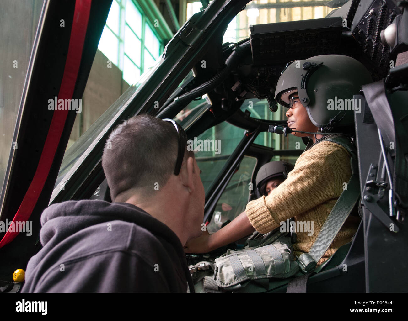 Shakyia Pendleton tries out the seat in a UH-60 Black Hawk during a Nov. 19, 2012 school visit to Simmons Army Airfield, - Stock Image