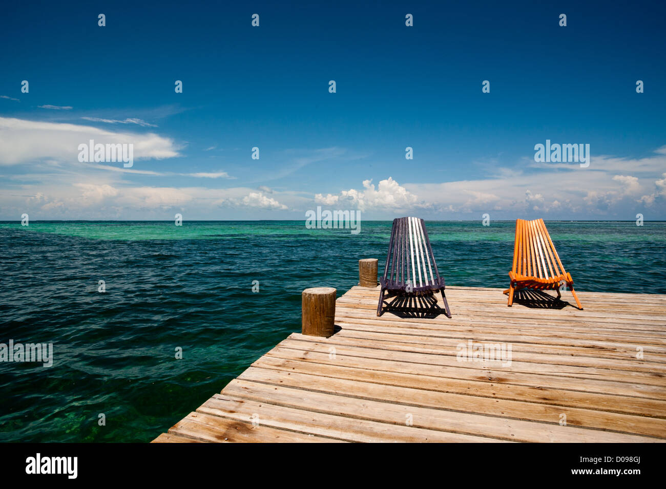 A dock and chairs on Tobacco Caye, Belize - Stock Image