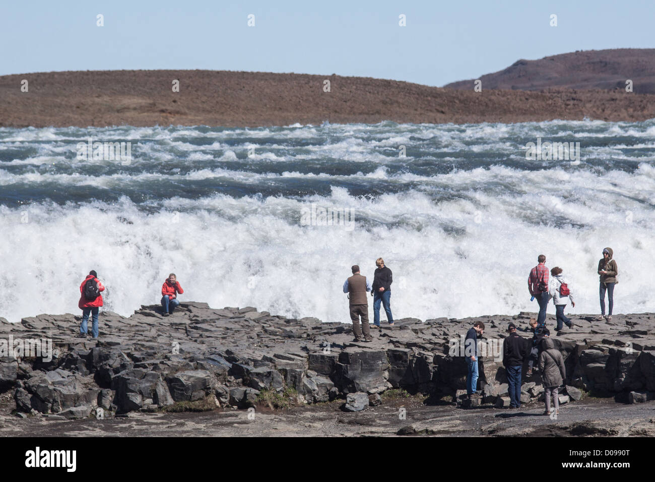 TOURISTS IN FRONT OF THE GULLFOSS FALLS A 32-METRE HIGH WATERFALL REGION OF THE GOLDEN CIRCLE ICELAND - Stock Image