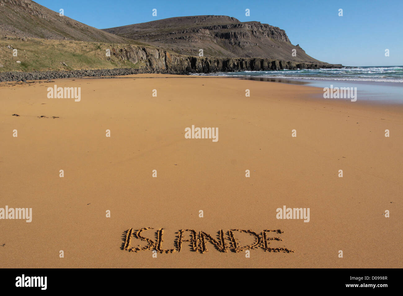 THE FRENCH NAME ICELAND WRITTEN IN EPHEMERAL MANNER IN SAND BEACH RAUDISANDUR REGION WESTERN FJORDS VESTFJORDS ICELAND - Stock Image