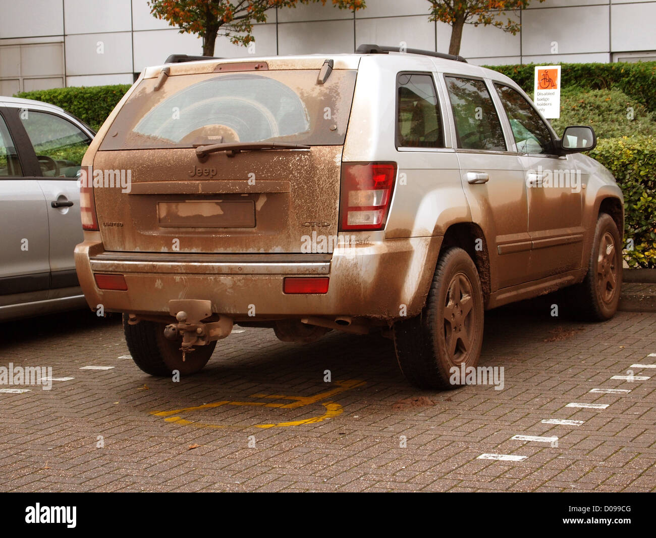 Muddy SUV 4x4 used as it was designed to be, not just the school run, Cribbs Causeway, Bristol, England, UK, 19th - Stock Image