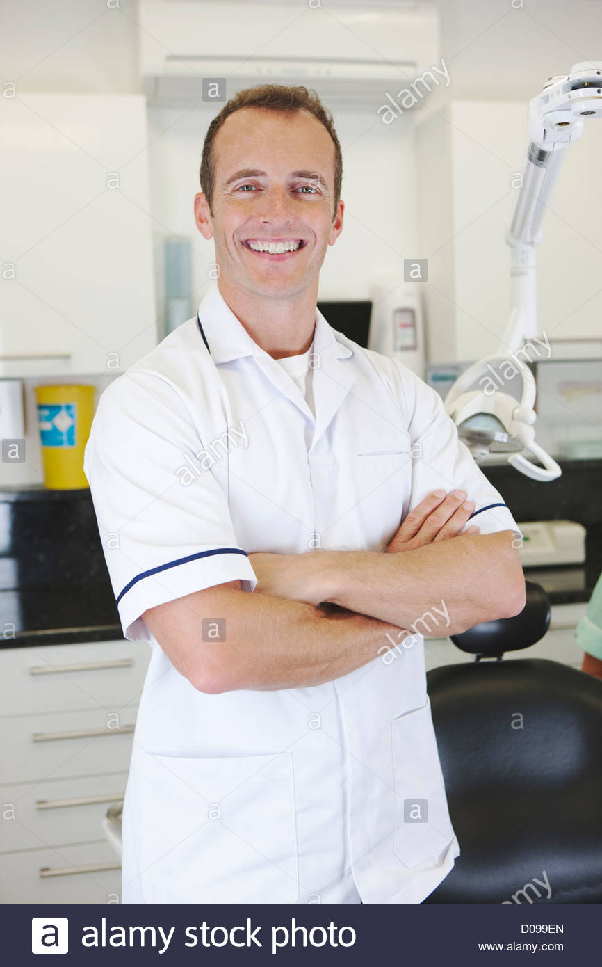A male dentist in a dental surgery - Stock Image