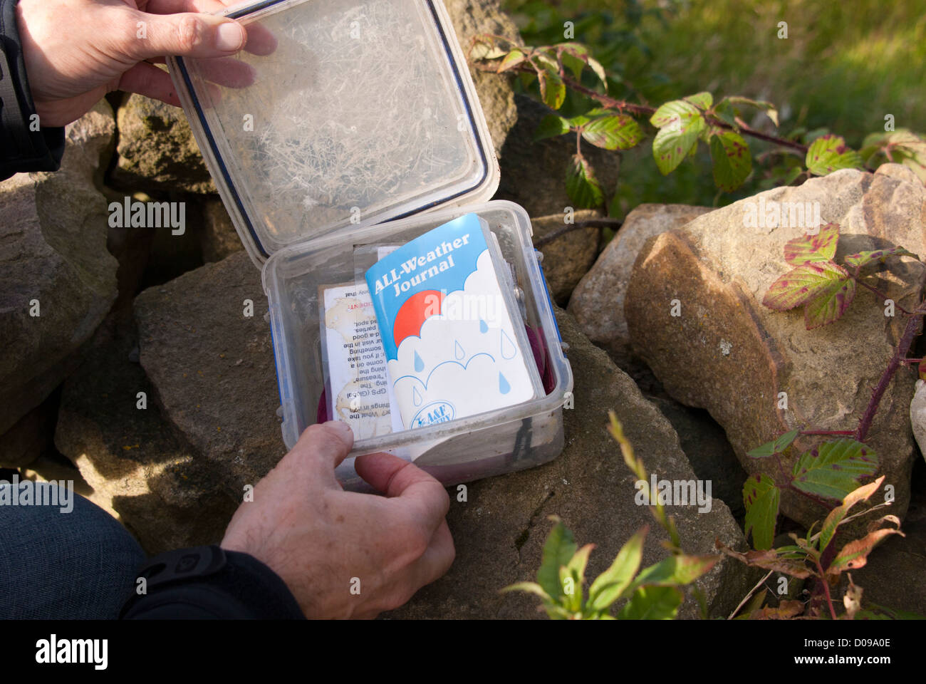 Opening a geocache box, Sheffield, South Yorkshire, England. Stock Photo