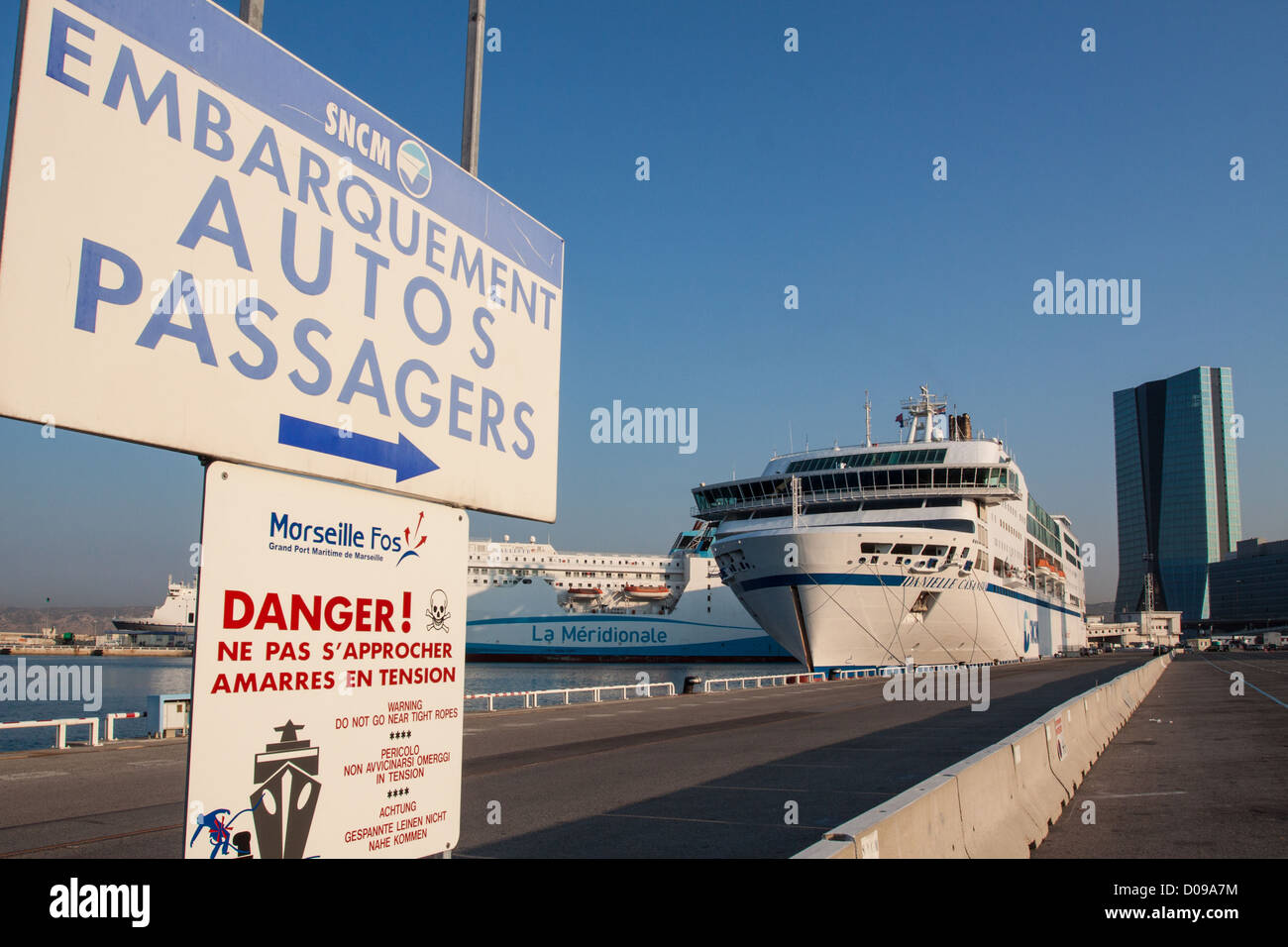 SIGN INDICATION CAR PASSENGER BOARDING FERRY DANIELLE CASANOVA FROM SNCM IN DISTANCE HEADQUARTERS WORLD MARITIME - Stock Image