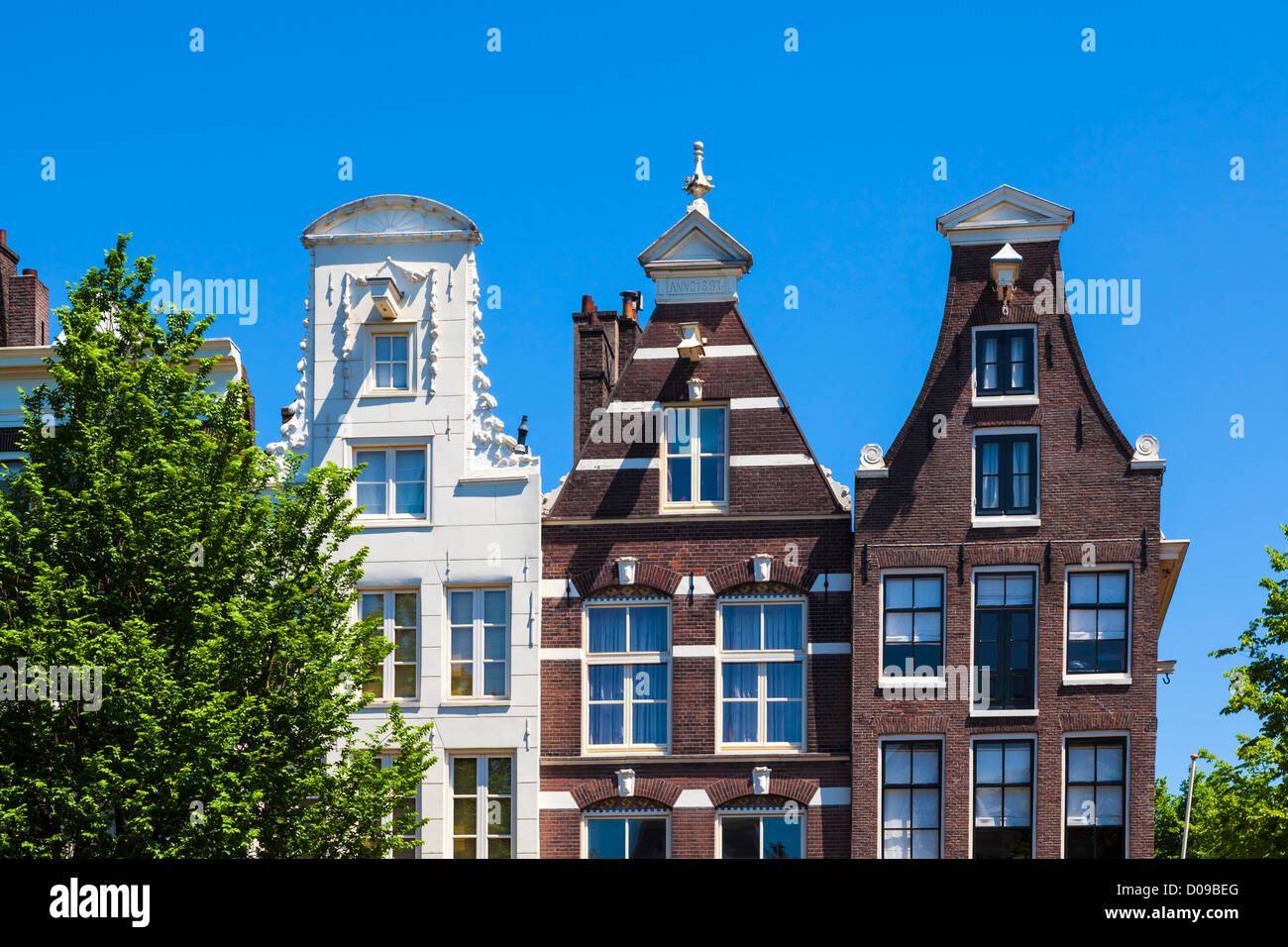 Typical gable houses in downtown Amsterdam, the Netherlands - Stock Image