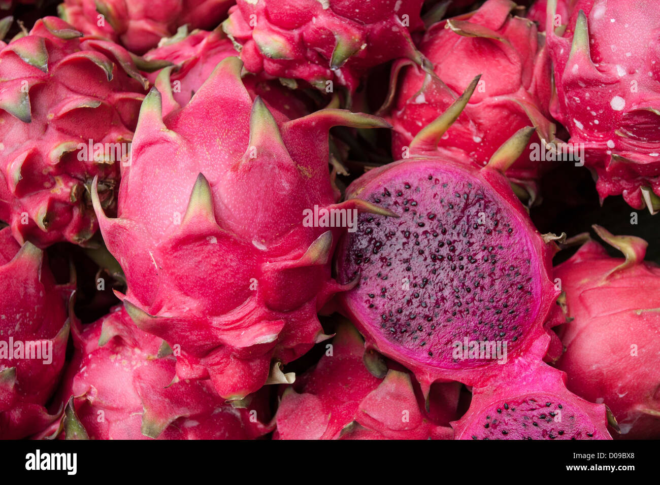 PITAYA ALSO CALLED DRAGON FRUIT ON A FRUIT SELLER'S STALL IN THE STREETS OF BANGKOK THAILAND ASIA - Stock Image