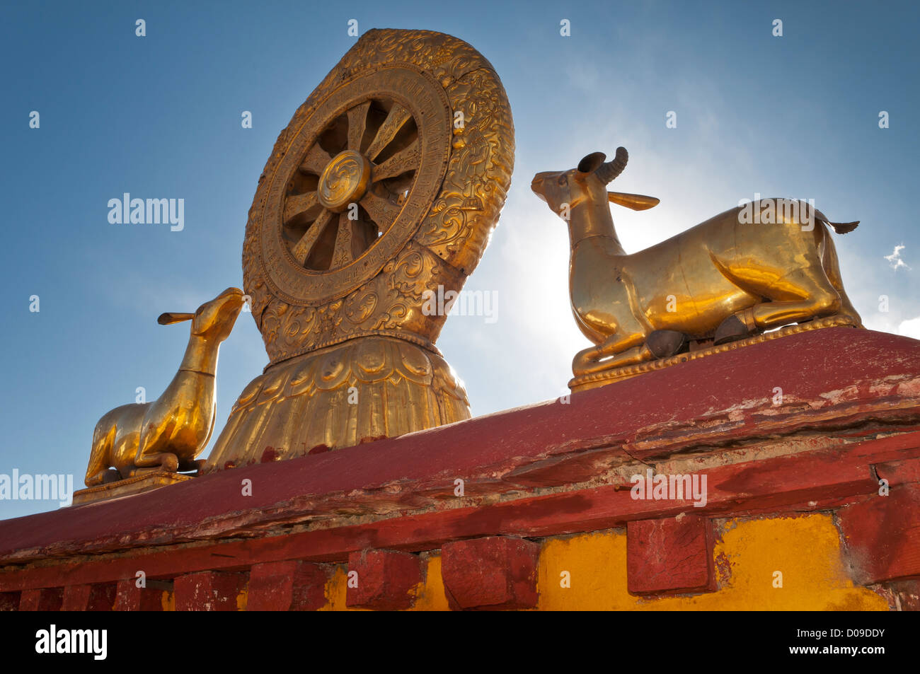 Larger than life size goldn lambs on roof of Tibet's most sacred Buddhist temple the Jokhang, Lhasa, Tibet, - Stock Image